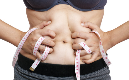 woman body with measuring tape isolated in white