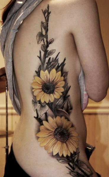 This-stylish-sunflower-tattoo-uses-subdued-colors-but-still-apears-fun-and-friendly