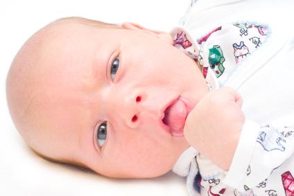 the portrait of newborn in high key technique