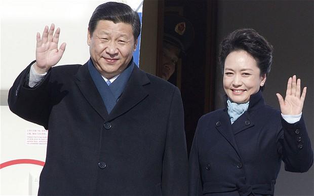 Peng Liyuan and her husband, Xi Jinping