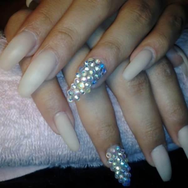 White nails plus beads acrylic nails design