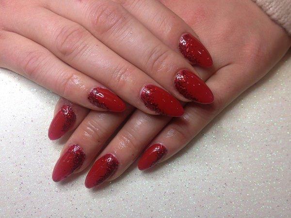 Dark red artificial nail polish