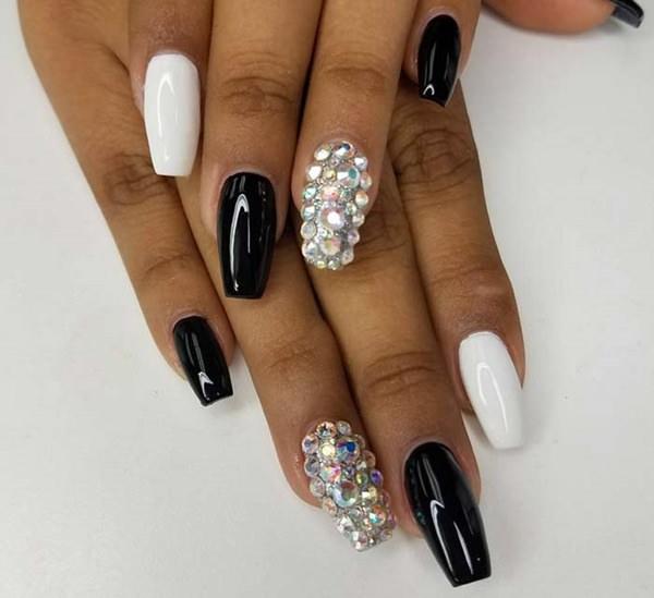 Black, white, and crystals fake nails design
